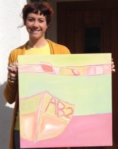 Landscape artist Sarah Nickless with one of her paintings